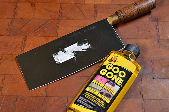 Dexter-Russel Chinese Vegetable Cleaver with Goo Gone to clean off residue.