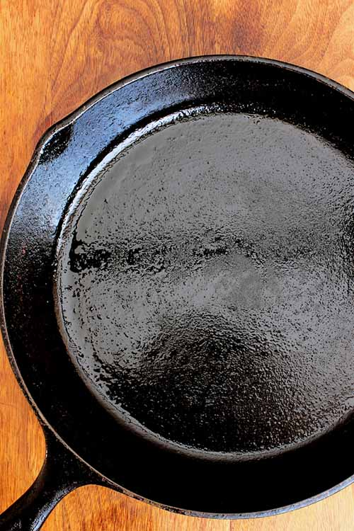 Your favorite cookware is caked with crusty food. Now, how to clean it correctly? Here's an awesome list of tips for sparkling cookware, without forsaking its quality or function: https://foodal.com/knowledge/cleaning/pots-pans-and-cookware/