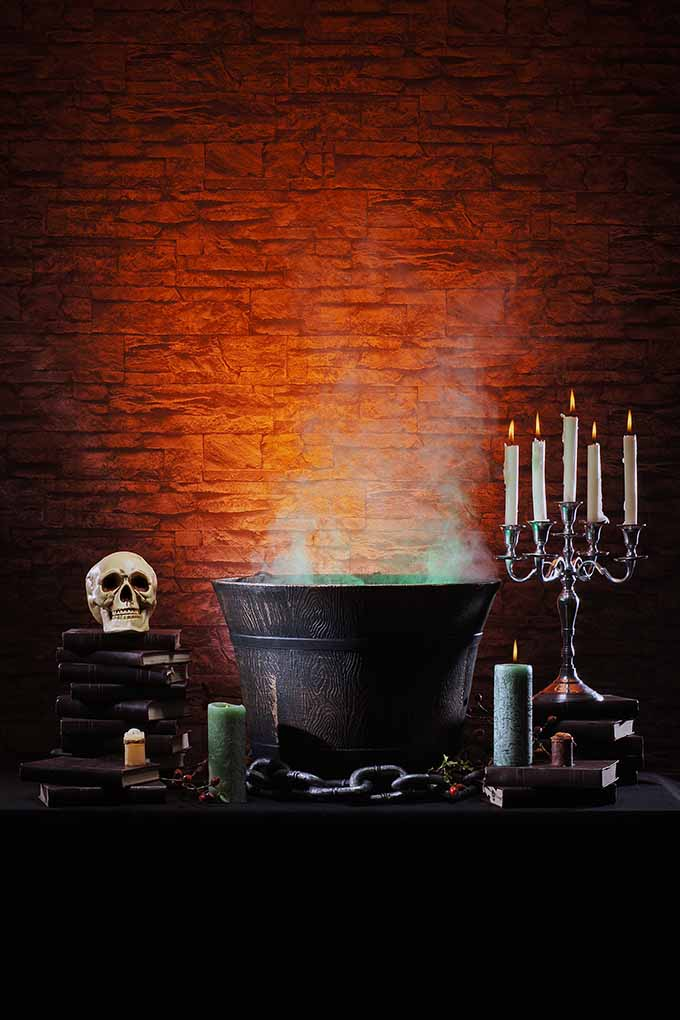 Spooky Halloween Table with Cauldron and Candelabra | Foodal.com