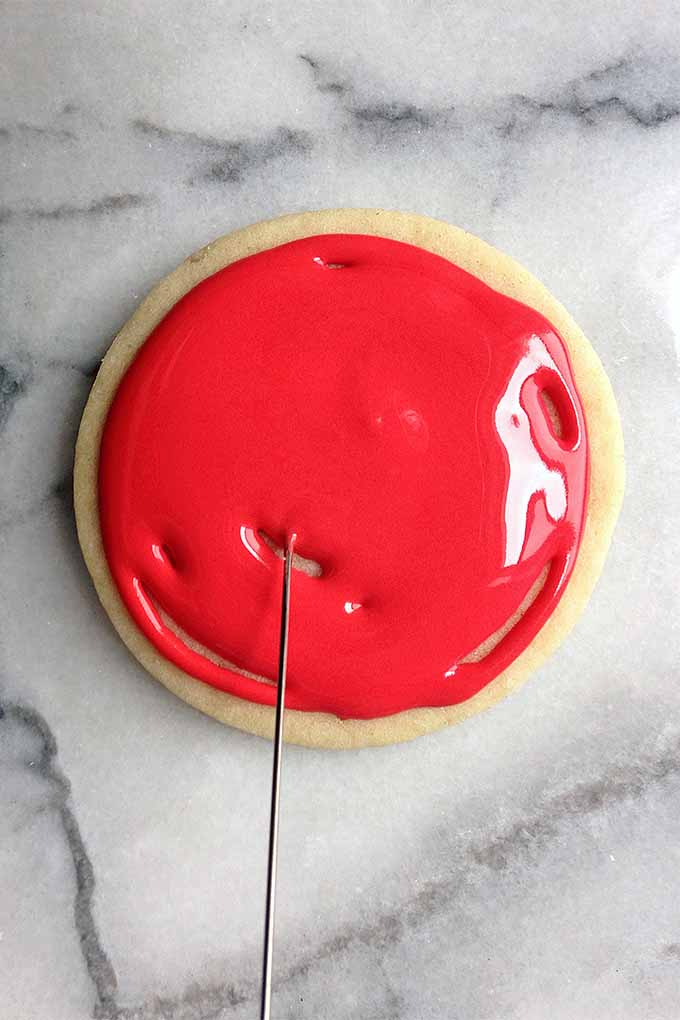 Learn how to decorate holiday sugar cookies like a pro, with our recipe for royal icing: https://foodal.com/recipes/desserts/decorate-holiday-cookies-royal-icing/