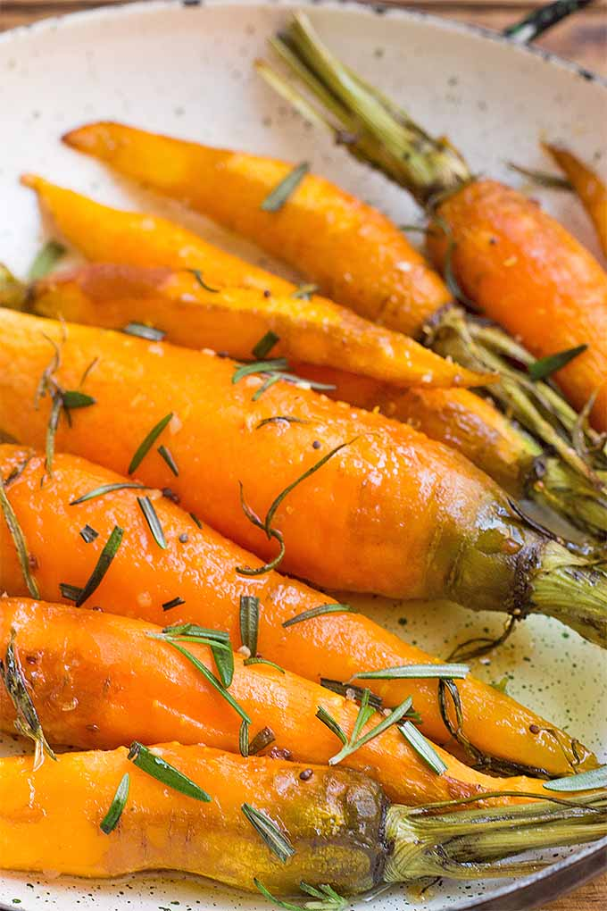 Want a side dish that's just a tad bit sweet, but still healthy? Give this roasted carrot recipe a try, complete with rosemary seasonings. It's the perfect warming food for cold weather!: https://foodal.com/recipes/veggies/roasted-rosemary-carrots/