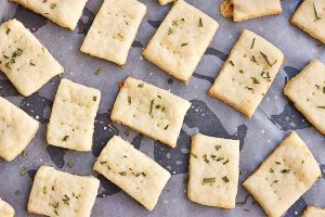 Top down view of baked Parmesan crackers on a baking sheet.