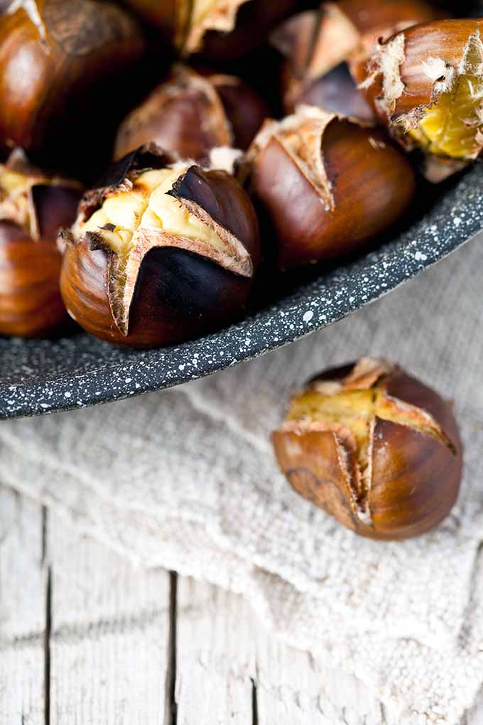"""Chestnuts roasting on an open fire..."" Ever wondered about the origins of this song? Apparently, roasted chestnuts are a beloved treat all around the world! Read more: https://foodal.com/holidays/christmas/roasted-chestnuts-a-globally-beloved-winter-treat"