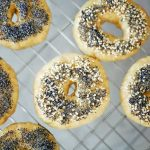Homemade Einkorn Bagels on a cooling rack. Top down view.