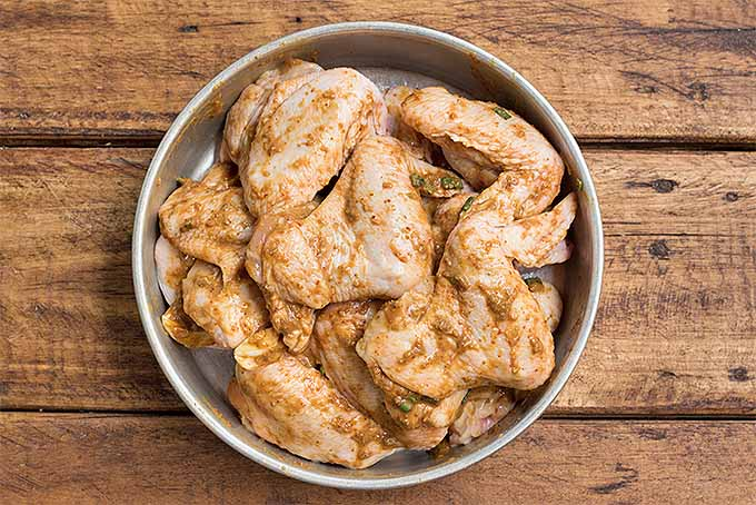 Marinating a batch of The Best Simple Spicy Chicken Wings. | Foodal.com