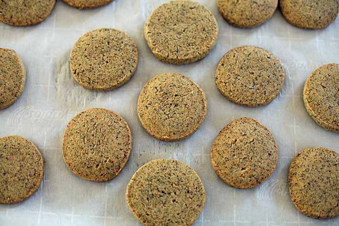 Einkorn flour Earl Grey tea cookies cooling on a surface of waxed paper. Top down view.