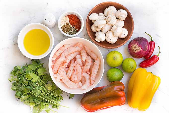 All of the ingredients required to make homemade sizzling shrimp fajitas. | Foodal.com