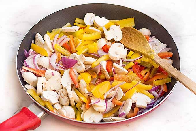 Saute fresh vegetables and marinated shrimp to make our recipe for sizzling shrimp fajitas. | Foodal.com
