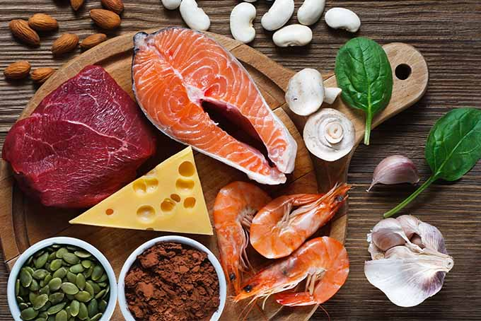 Healthy foods that are rich in zinc include salmon, beef, shrimp, cheese, pumpkin seeds, cocoa powder, mushrooms, spinach, almonds, beans, and garlic. | Foodal.com