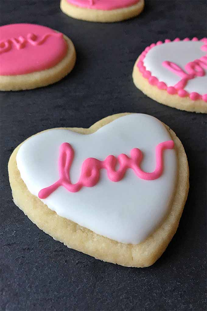 Make something special that's from the heart this Valentine's Day - who could say no to a batch of sweet sugar cookies, decorated so adorably with pink and white royal icing? Learn how: https://foodal.com/recipes/desserts/cookie-decorating-tips-valentines-day/