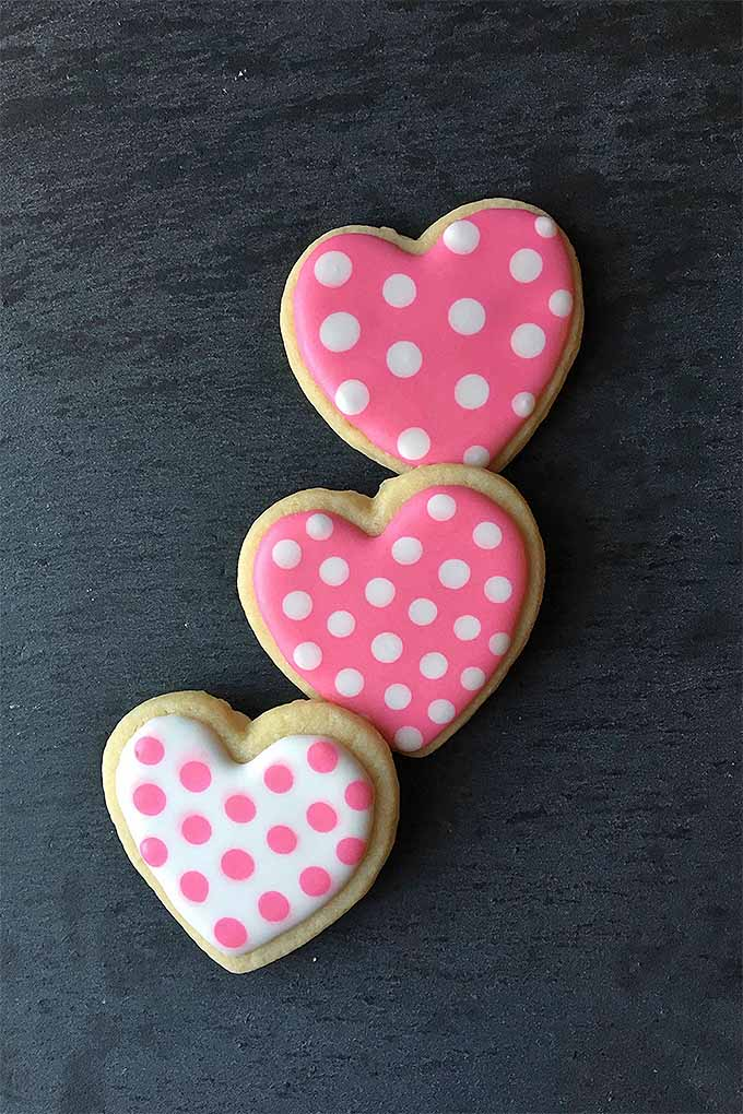 Learn how to decorate sugar cookies like a pro this Valentine's Day. We explain all of the top techniques, like the best way to make royal icing polka dots: https://foodal.com/recipes/desserts/cookie-decorating-tips-valentines-day/