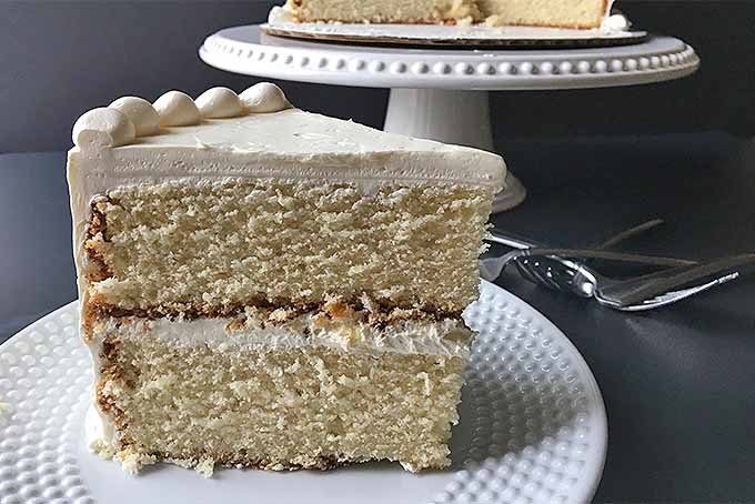 A thick slice of homemade vanilla butter cake | Foodal.com