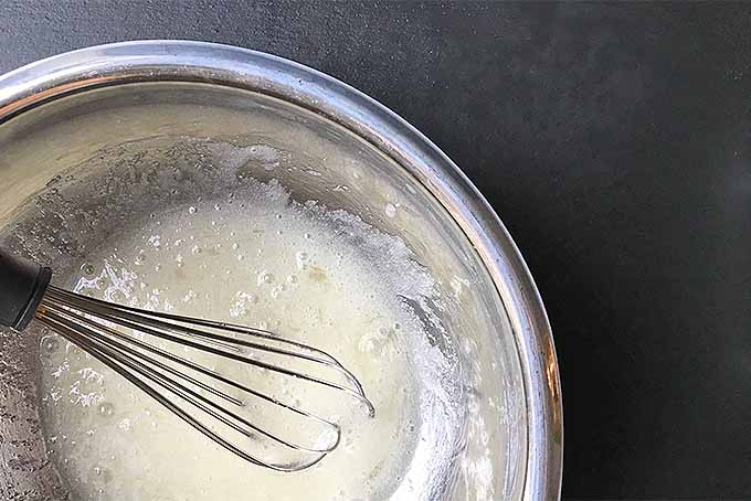 A whisked mixture of eggs and sugar for Swiss meringue buttercream | Foodal.com