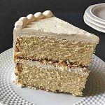 Perfect slice of homamde vanilla butter cake with icing   Foodal.com