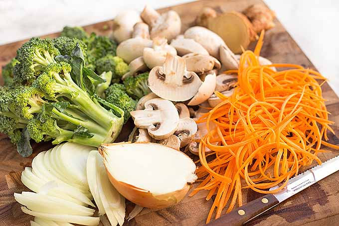 Getting all the veggies prepped for a chicken and shrimp lo mein meal | Foodal.com