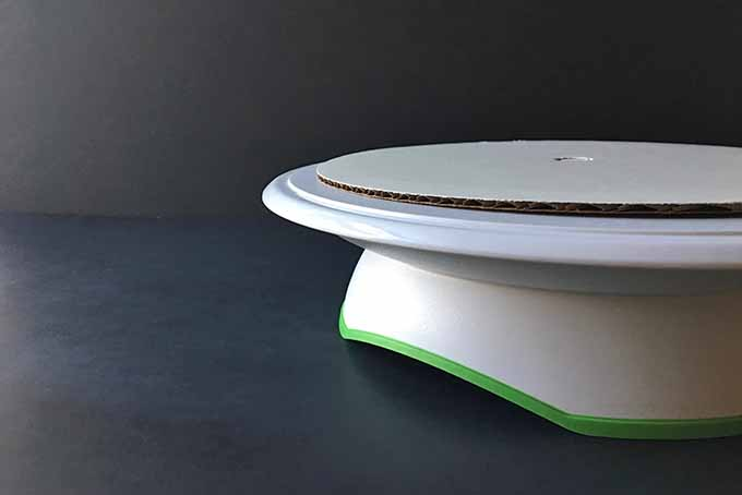 One cake board on a turntable, ready for the cake | Foodal.com