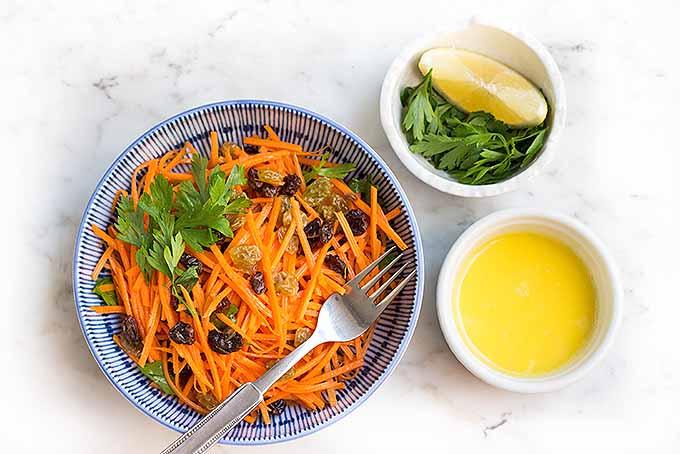 Homemade carrot and raisin salad, with fresh parsley and lemon garlic aioli. | Foodal.com
