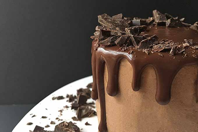 Chocolate cake covered in decadant ganache | Foodal.com