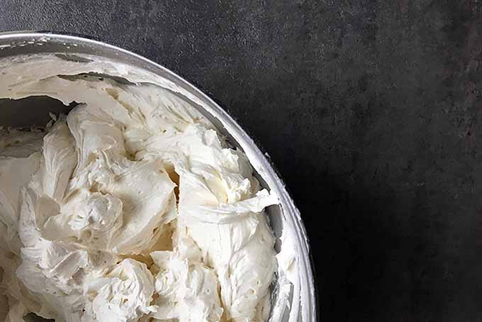 A bowl of freshly whipped American-style vanilla frosting, straight from the mixer | Foodal.com
