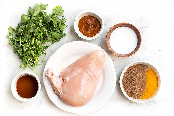Prepping ingredients to marinate chicken for a spicy chicken satay dish. | Foodal.com