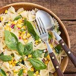 Pasta salad with corn, onions, basil and lemon. | Foodal.com