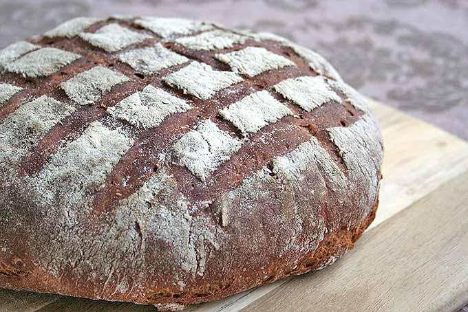 A loaf of German dark rye bread, freshly made. | Foodal.com