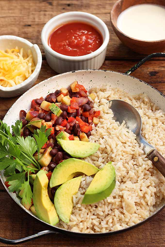 Need an idea for your Meatless Monday meal? Try our hearty and flavorful vegetarian burrito bowl! We share the recipe: https://foodal.com/recipes/vegetarian-vegan/vegetarian-burrito-bowl/