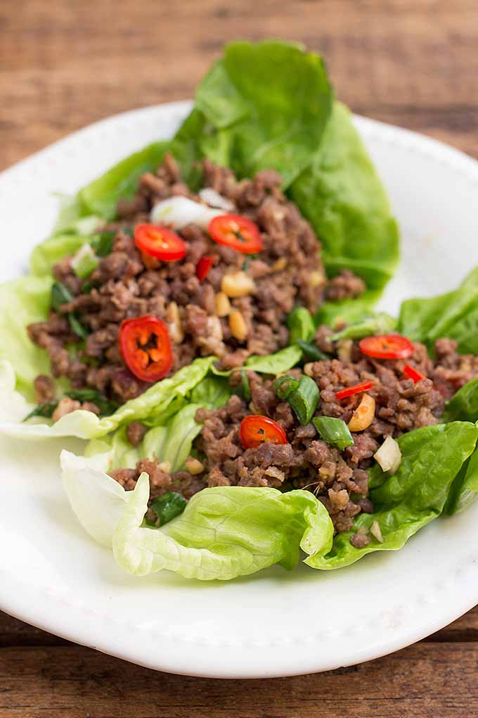 Love eating without utensils? Grab one of our handheld spicy ground beef lettuce wraps for dinner tonight. We share our tasty recipe: https://foodal.com/recipes/beef/spicy-ground-beef-lettuce-wraps/
