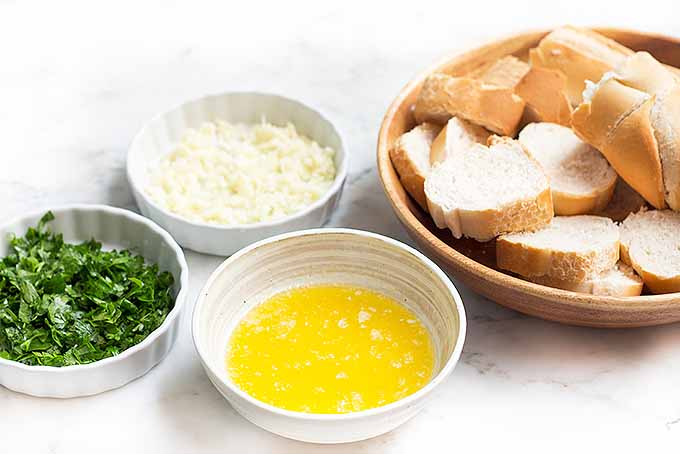 The ingredients for quick and easy garlic bread. | Foodal.com