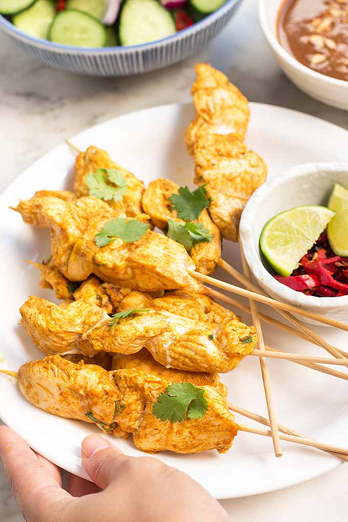 If you love big flavors, try our spicy chicken satay with peanut dipping sauce and cool cucumber salad. We share this flavorful recipe on Foodal: https://foodal.com/recipes/poultry/chicken-satay/