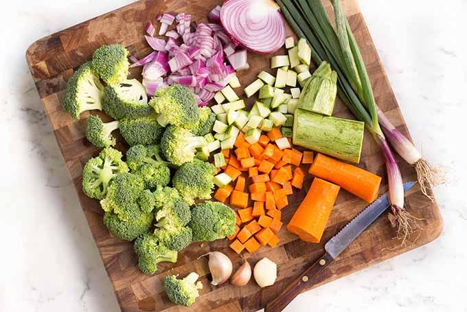 Prepping assorted veggies for our lemon chicken quinoa bowl. | Foodal.com