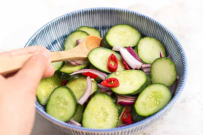 A cold and refreshing cucumber salad to cool down your mouths from our spicy chicken satay recipe. | Foodal.com
