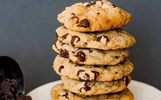 Close up of a stack of vegan chocolate chip cookies.