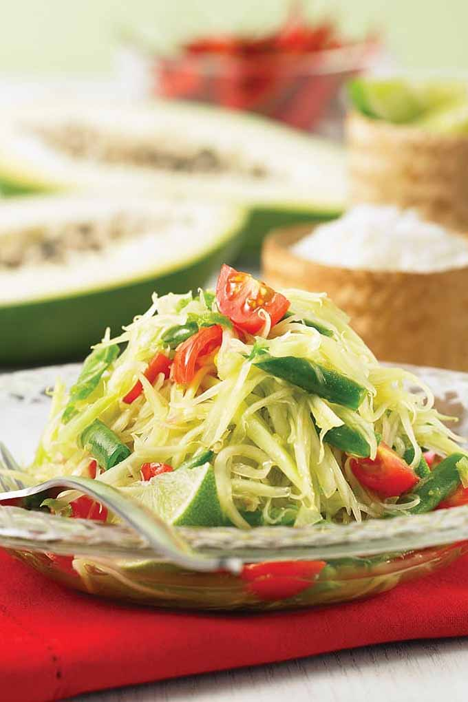 If you love the flavors of Thai cuisine, check out our round up of 15 Thai-inspired dishes, like this fresh green papaya salad. We share all the recipes: https://foodal.com/knowledge/paleo/thai-recipe-roundup/