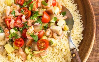Enjoy a healthy bowl of couscous with shrimp and mixed vegetables. | Foodal.com