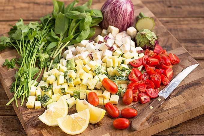Chopping all the veggies for a healthy meal. | Foodal.com