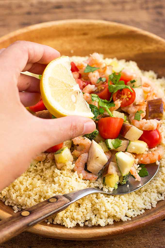 Enjoy a healthy bowl of couscous with shrimp and mixed vegetables in under 30 minutes! We share our recipe: https://foodal.com/recipes/pasta/homemade-couscous-with-eggplant-zucchini-and-shrimp/