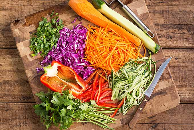 Prepping a colorful array of veggies for a soba noodle salad. | Foodal.com