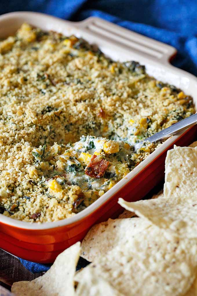 This kale, corn, and bacon dip is perfect for summertime parties and barbecues. Check out our roundup of the best sweet corn recipes: https://foodal.com/knowledge/paleo/best-sweet-corn-recipes/