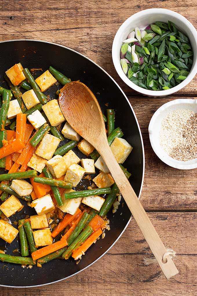 If you're looking for a vegetarian recipe that's also high in protein and flavorful at the same time, try our spicy Sriracha tofu stir-fry with green beans and carrots. We share the recipe: https://foodal.com/recipes/vegetarian-vegan/sriracha-tofu-vegetable-stir-fry/