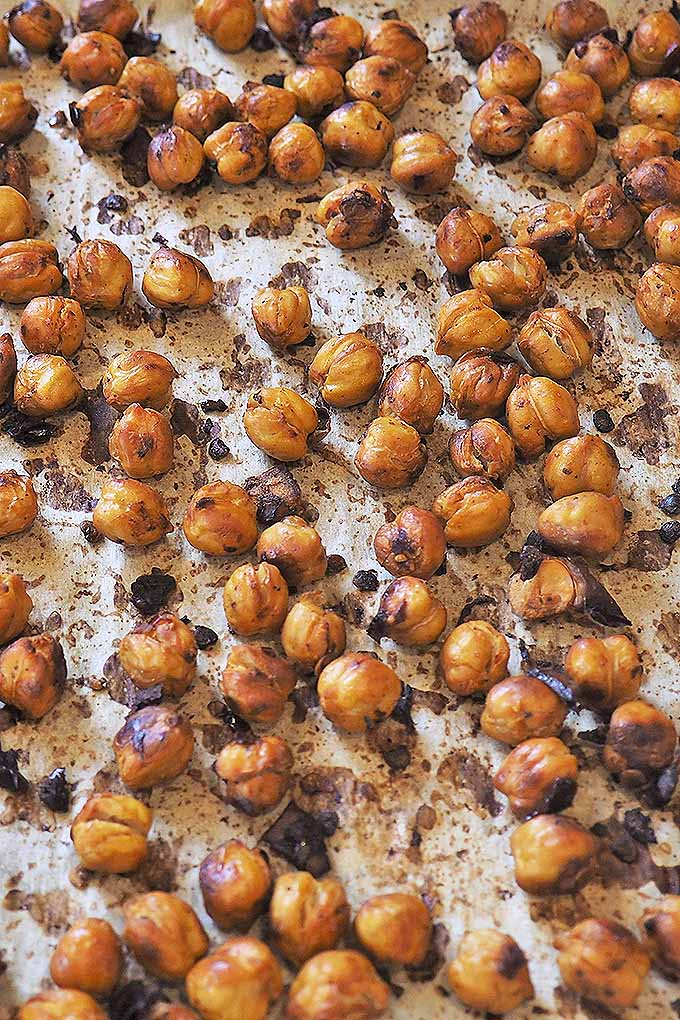 Crave crunchy, salty snacks? Step away from the bag of potato chips, and try theses oven-roasted spicy chickpeas! They are full of flavor and so good for you! Get the recipe now: https://foodal.com/recipes/grains-and-legumes/smoky-spicy-roasted-chickpeas/