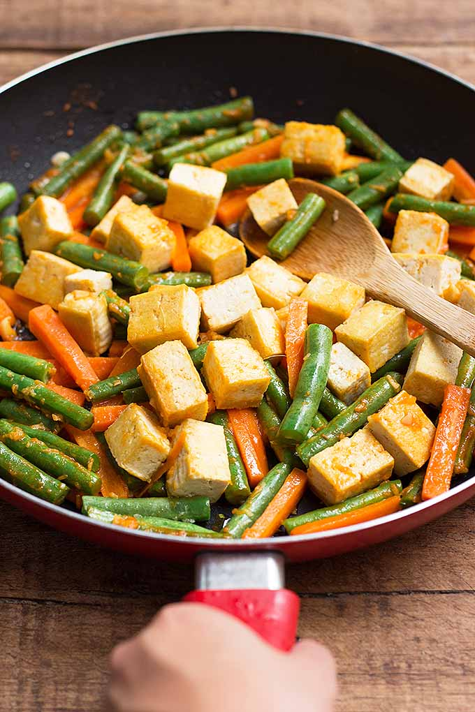 Sriracha tofu and vegetable stir-fry is a perfect dish for Meatless Mondays! Get this spicy recipe on Foodal: https://foodal.com/recipes/vegetarian-vegan/sriracha-tofu-vegetable-stir-fry/