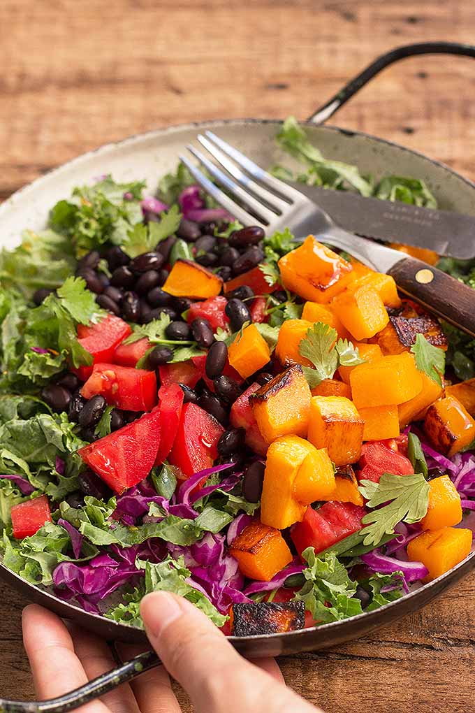 This fiesta kale salad is ideal for warm summer days – with ingredients like beans, tomatoes, sweet potatoes, and a citrusy dressing, it's refreshing, vibrant, and healthy! We share the recipe: https://foodal.com/recipes/salads/fiesta-kale-salad/