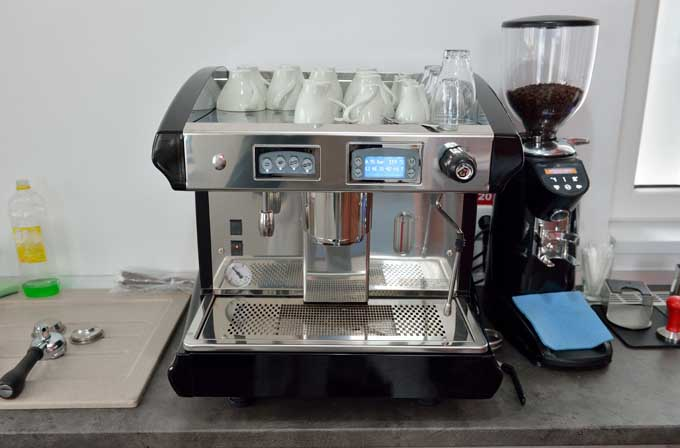 A home espresso machine with a coffee grinder.