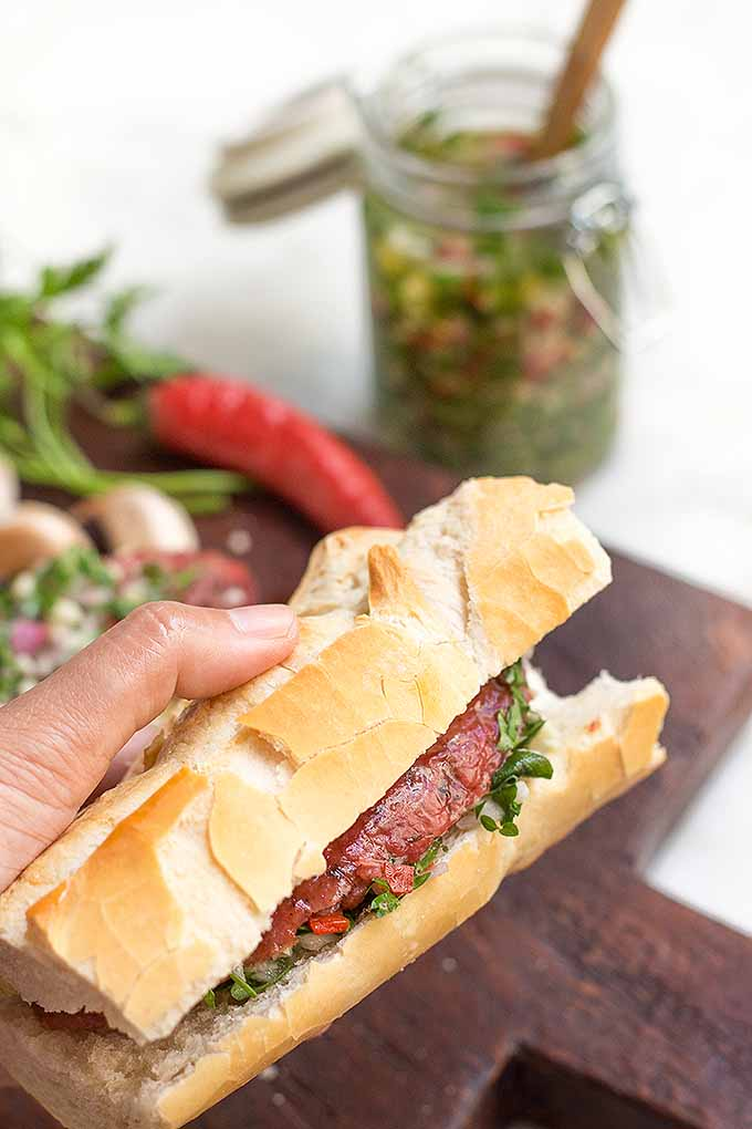 This Argentine choripan with chimichurri has flavors that will blow your taste buds away! Spicy, sour, savory, and sweet, get the recipe now on Foodal: https://foodal.com/recipes/sandwiches/argentine-choripan-chimichurri/