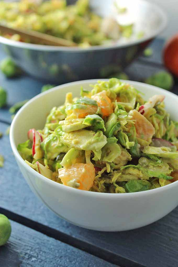 Learn why cooks all over America are adding miso paste to their dishes, like in this ginger Brussels sprouts salad. Get more info and recipe ideas for this ancient Japanese flavor weapon now: https://foodal.com/knowledge/paleo/all-about-miso/