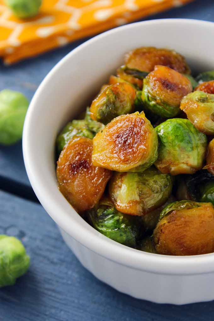 Learn all about the fascinating history of spicy Sriracha sauce, the made-in-America condiment that is perfect on so many different dishes, like these Brussels sprouts! Get more info now: https://foodal.com/knowledge/paleo/all-about-sriracha/