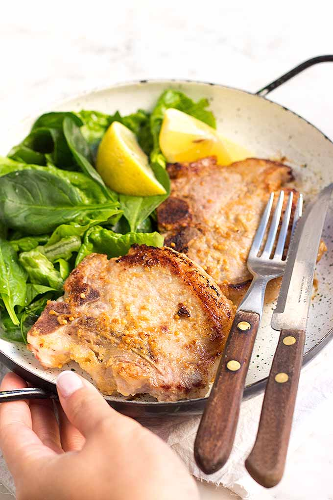 This recipe for simple but delicious pork chops is going to be your favorite quick weeknight meal! We share the recipe: https://foodal.com/recipes/pork/honey-mustard-chops/