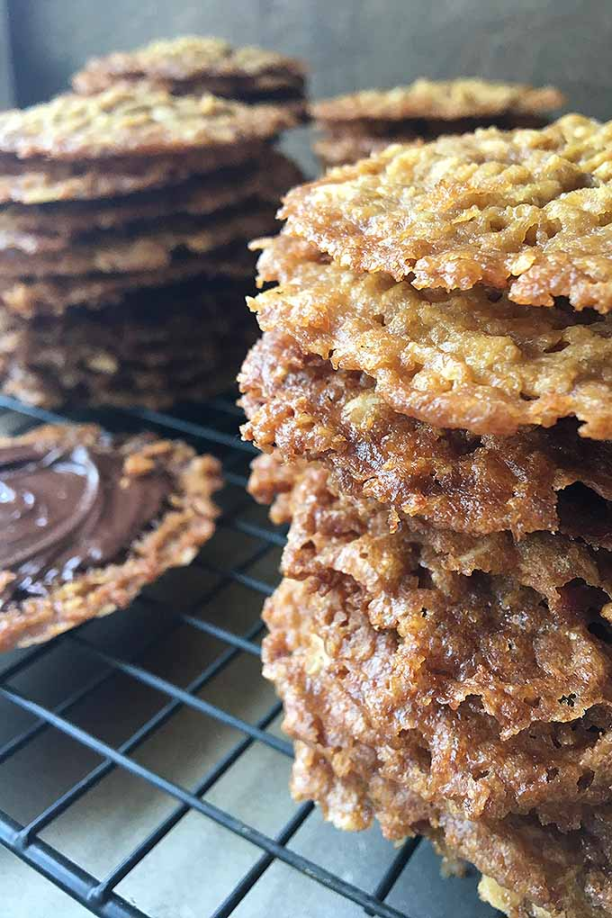 Oat lace cookies are buttery, crispy, and have the most deep caramel flavor. Make these beautiful, flavorful treats for your next special occasion: https://foodal.com/recipes/desserts/beautiful-lace-cookies/