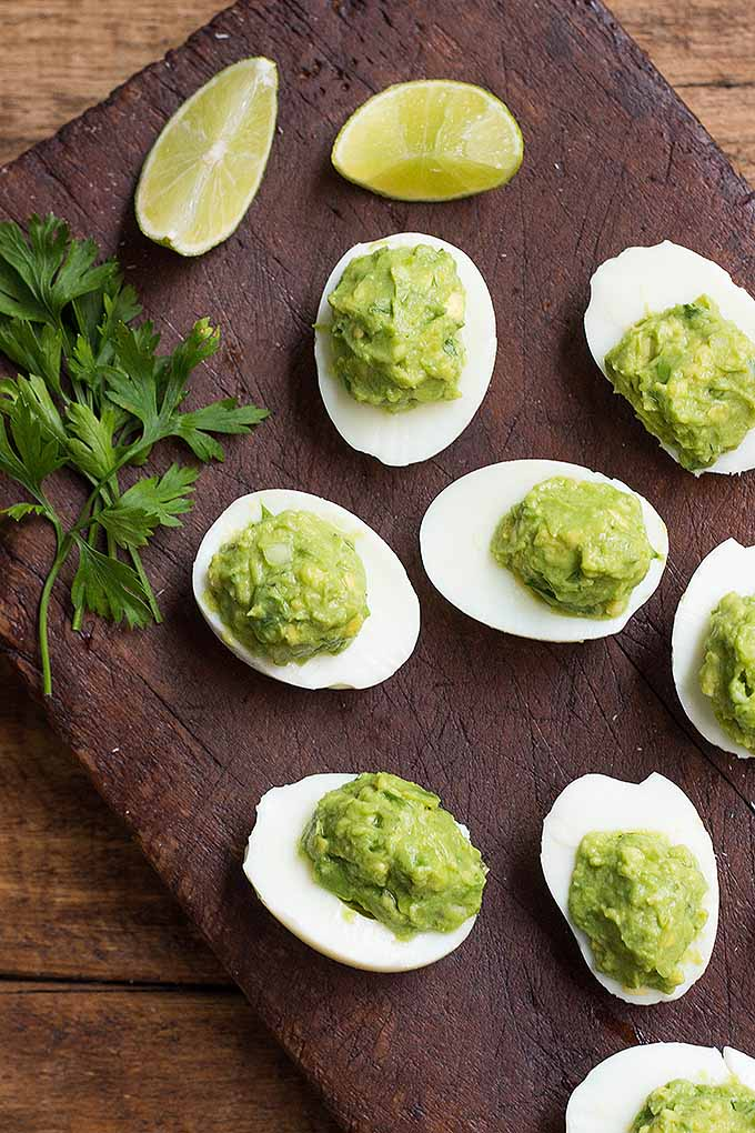 Take the classic deviled eggs up a notch by making this healthier option instead, using a fresh avocado filling! We share the recipe: https://foodal.com/recipes/appetizers/guacamole-deviled-eggs/